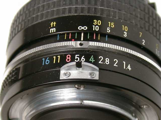 A manual aperture ring on an older lens